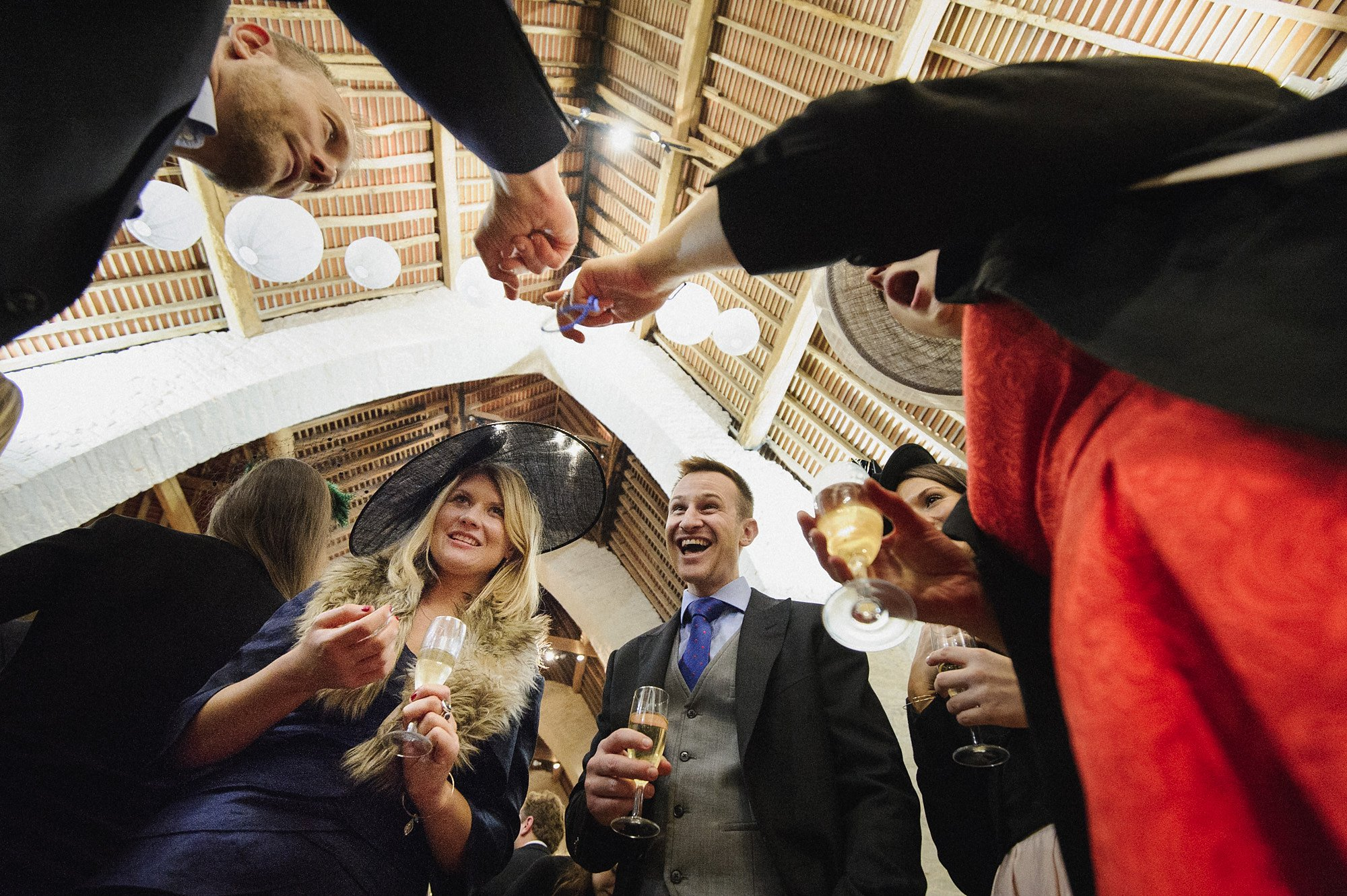 guests look on with amazement at the wedding magician's tricks
