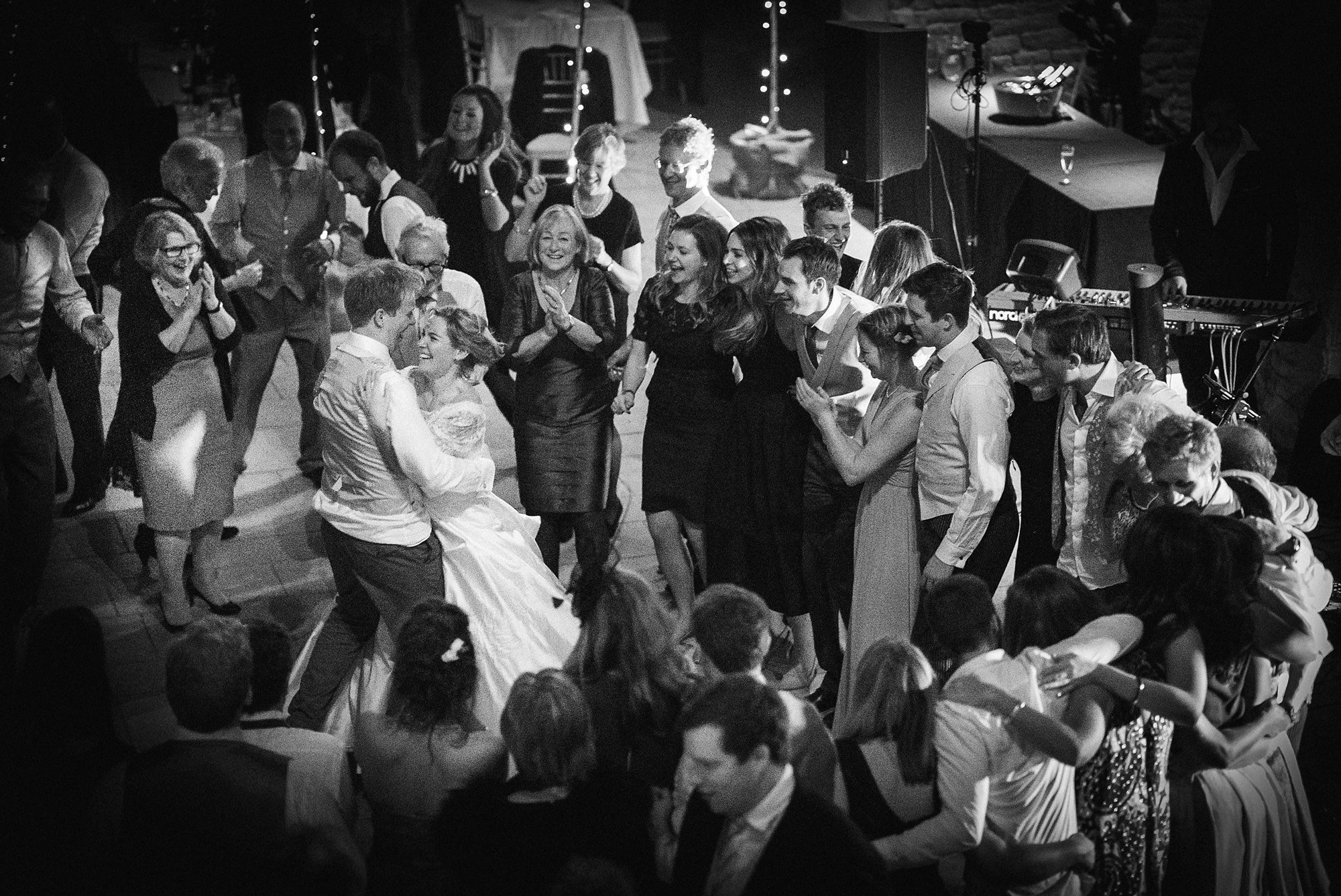 wedding guests surround the couple for their last dance of the night