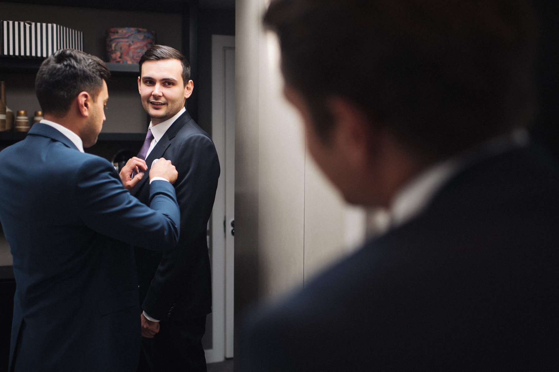the best man helps the groom to get ready for his london wedding