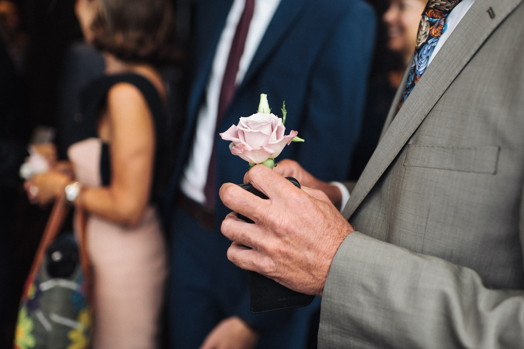 a flower for the groom