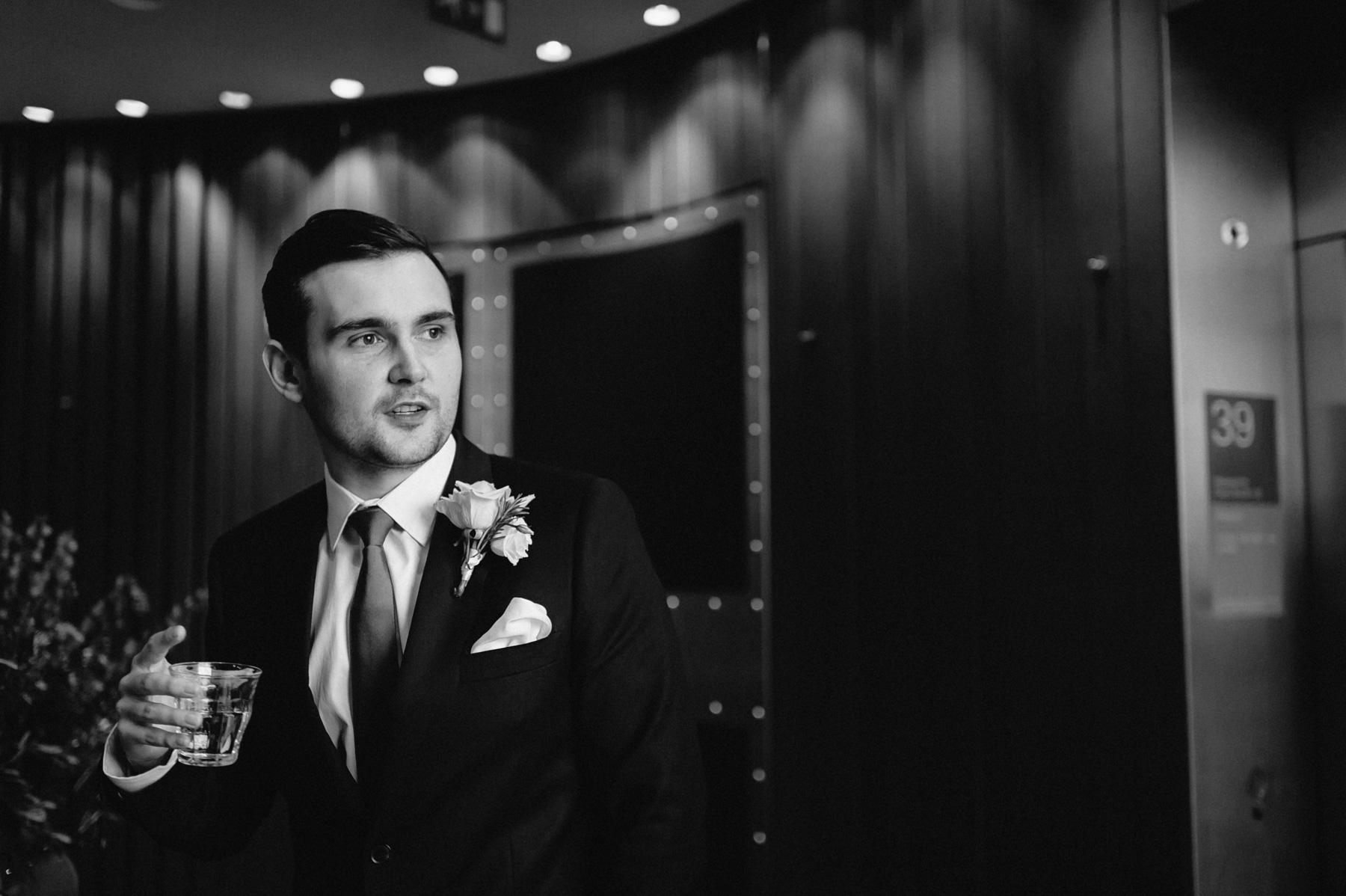 the groom waits nervously