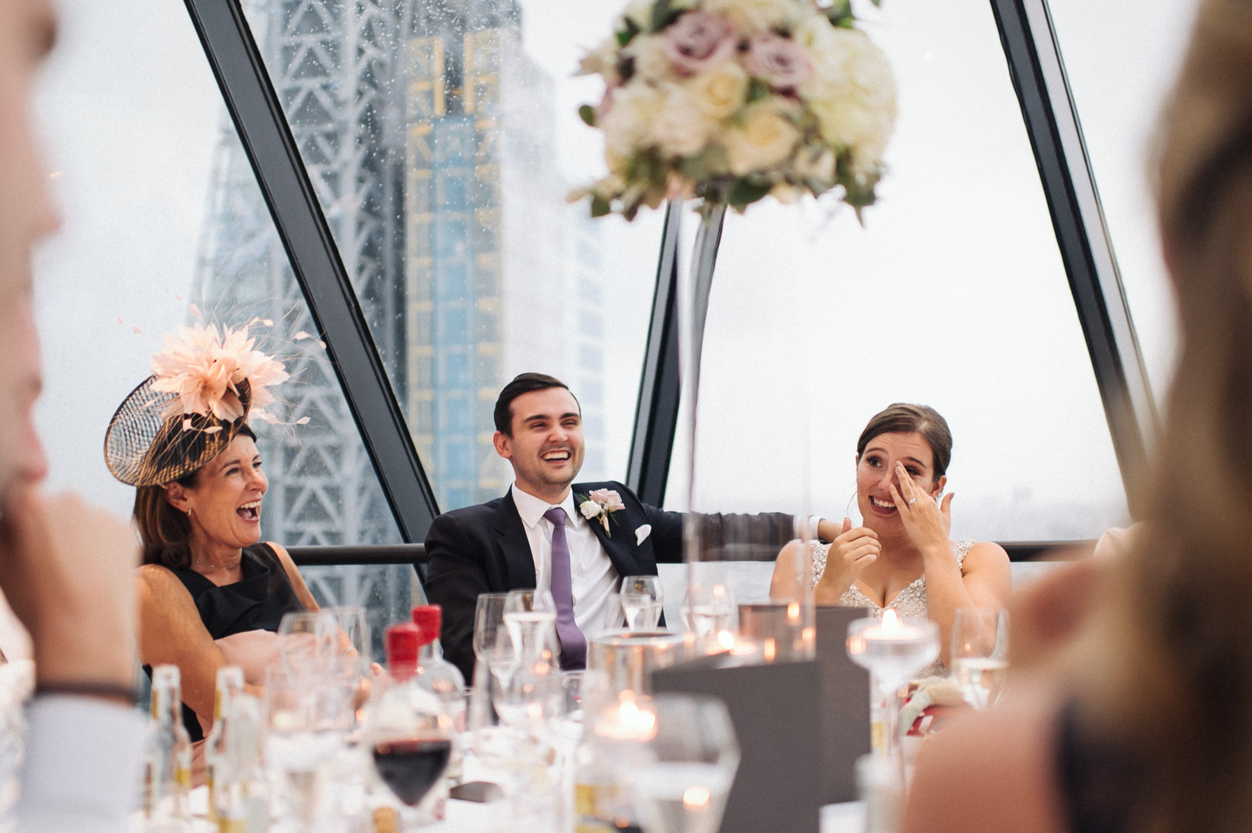the bride wipes away happy tears