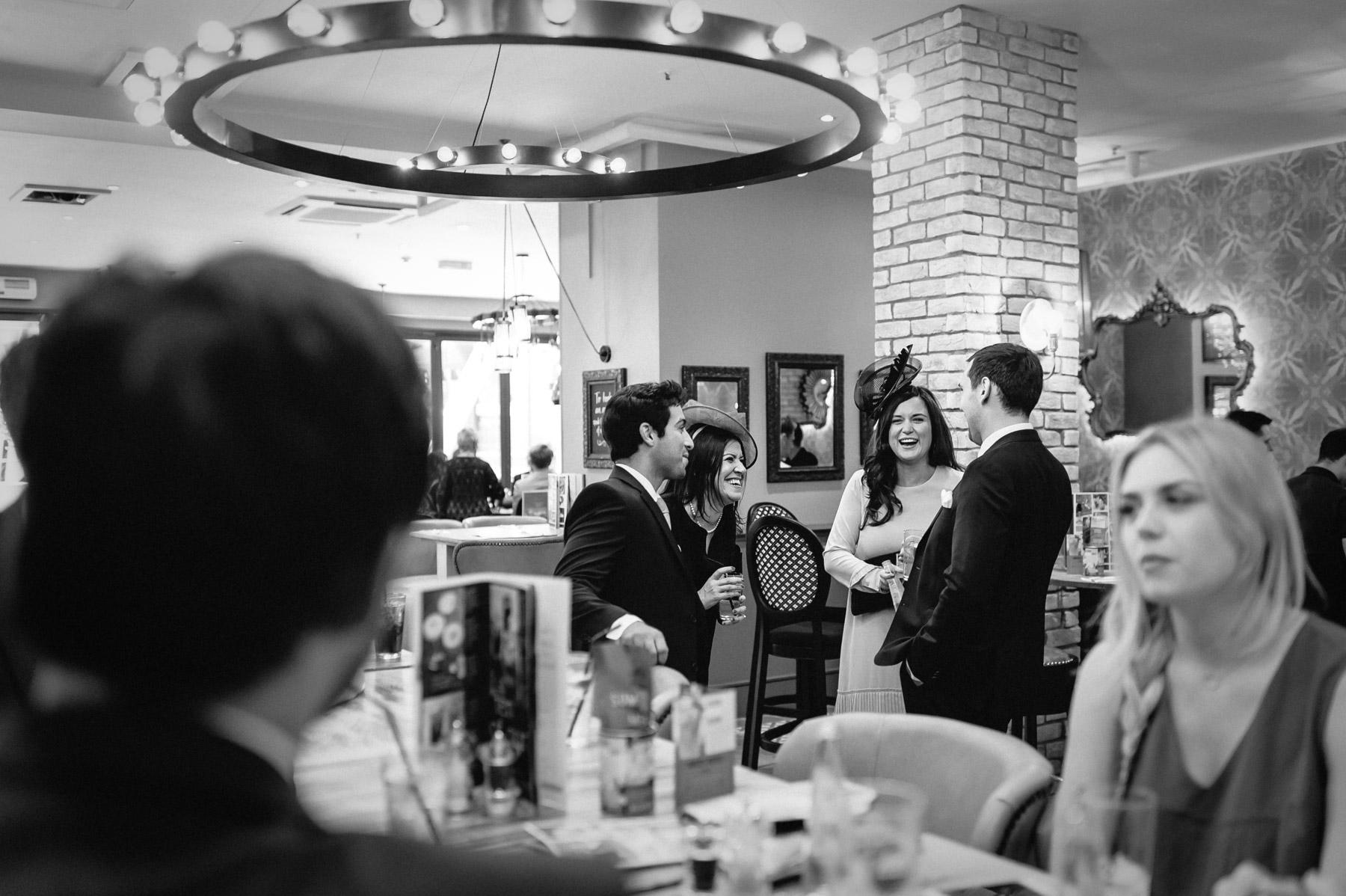 wedding guests meet at a bar before the wedding