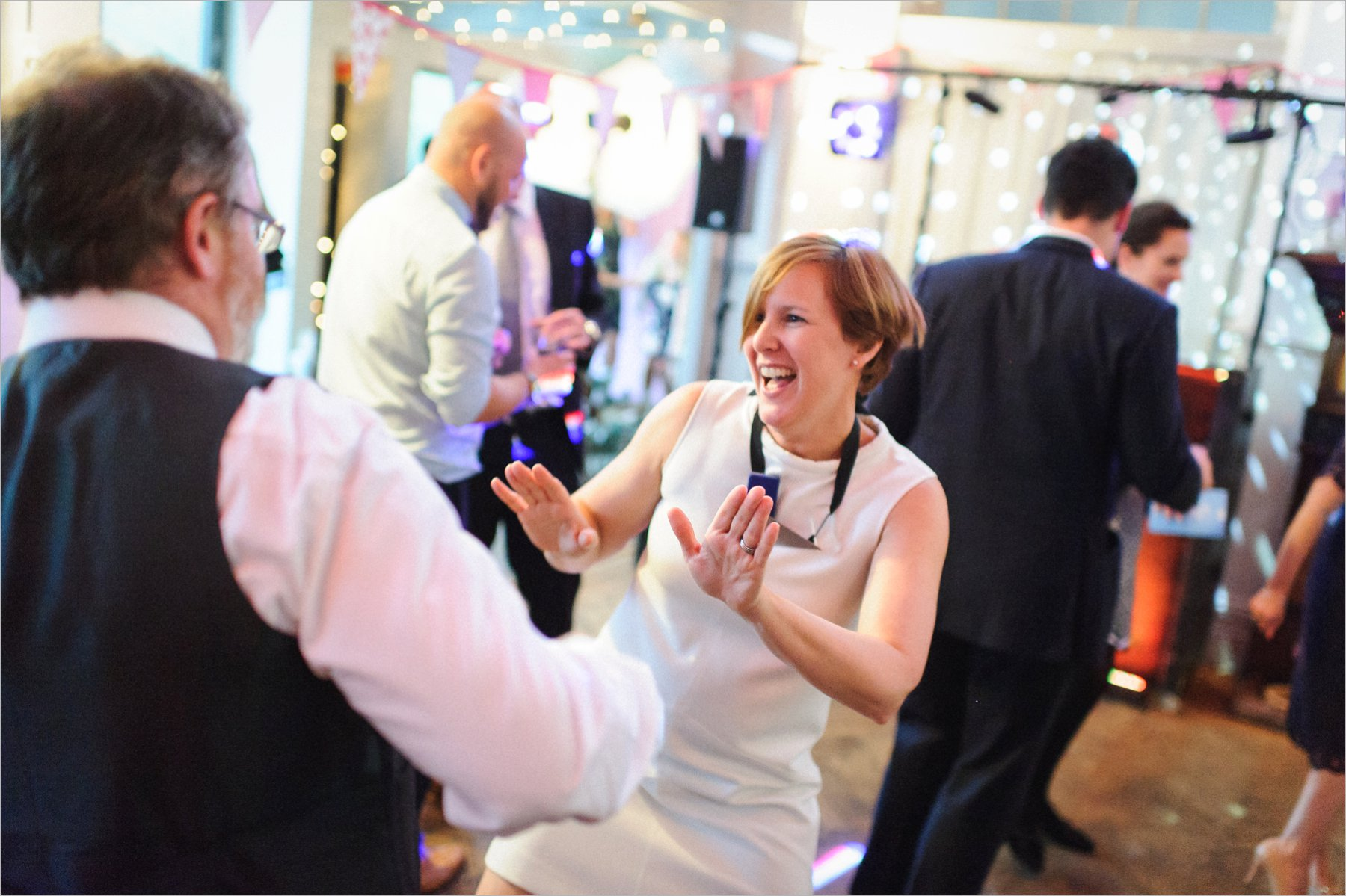 throwing some shapes at the wedding disco