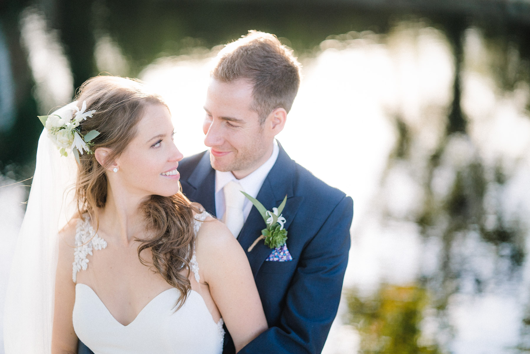 bride and groom pose for their wedding photography at micklefield hall