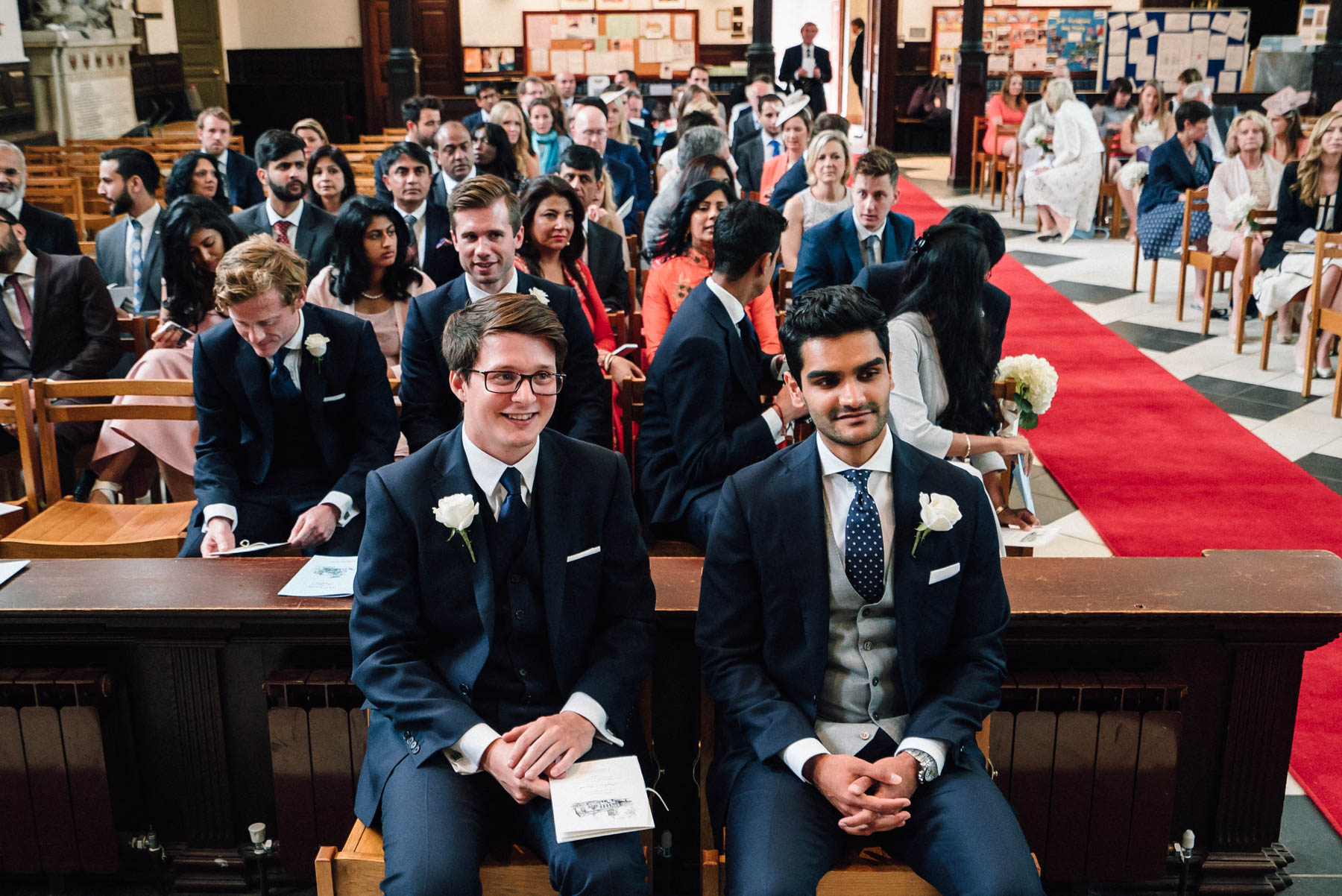 Anish and his best man wait patiently at holy trinity church on Guildford high street