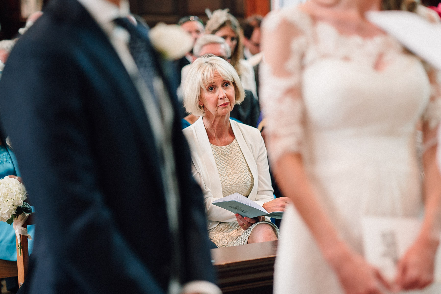 An emotional mum during the wedding ceremony in Surrey