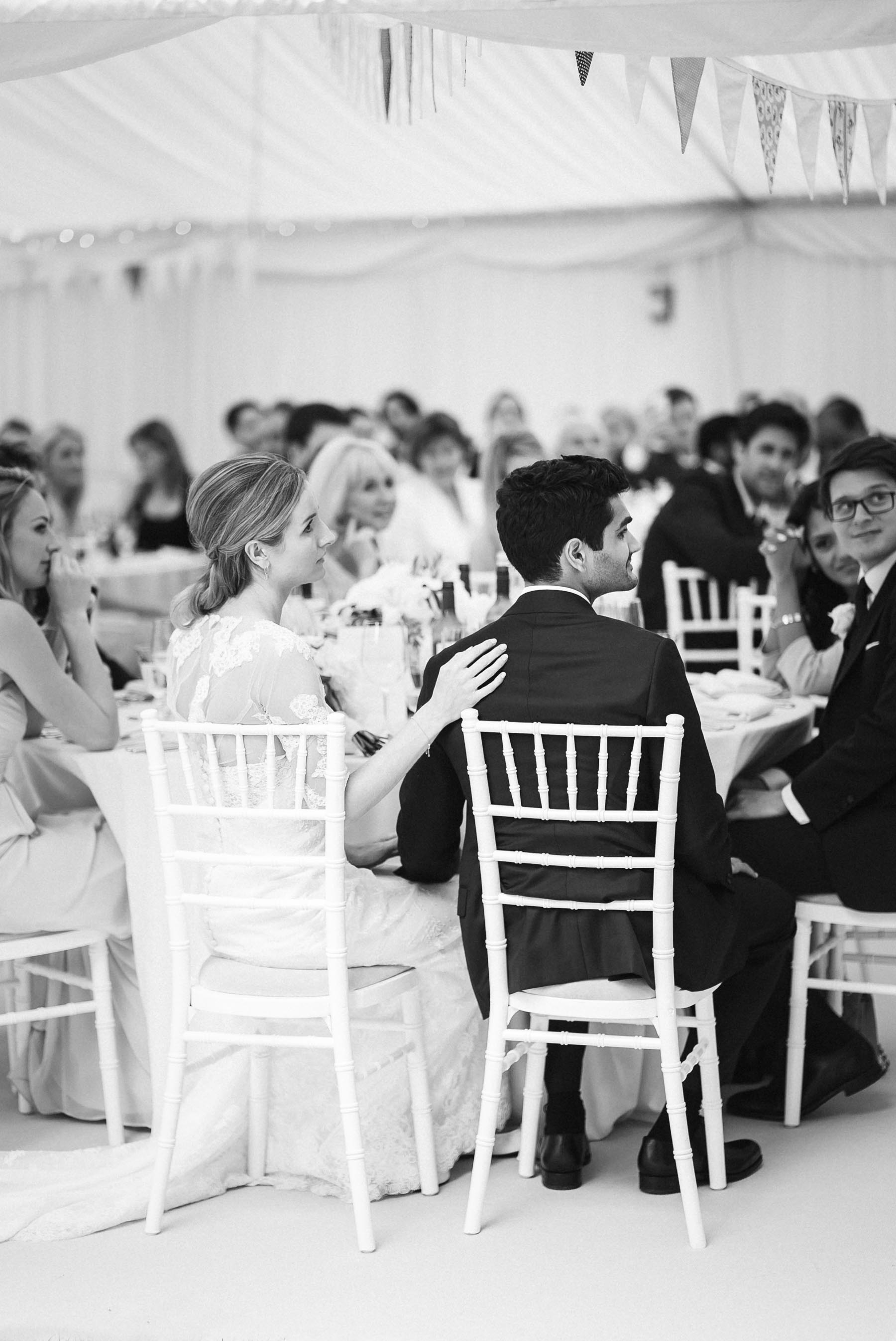 a comforting hand during the wedding speeches