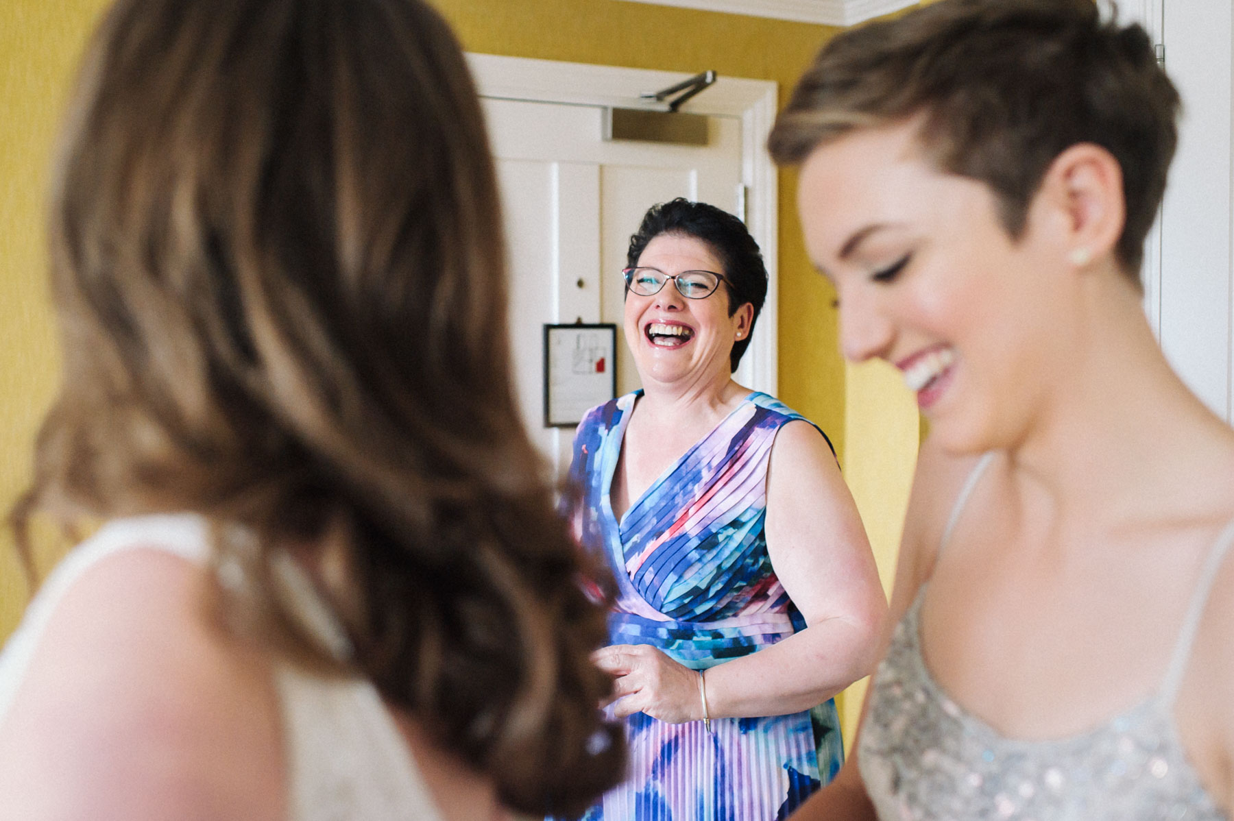 the mother of the bride has a laugh during bridal prep