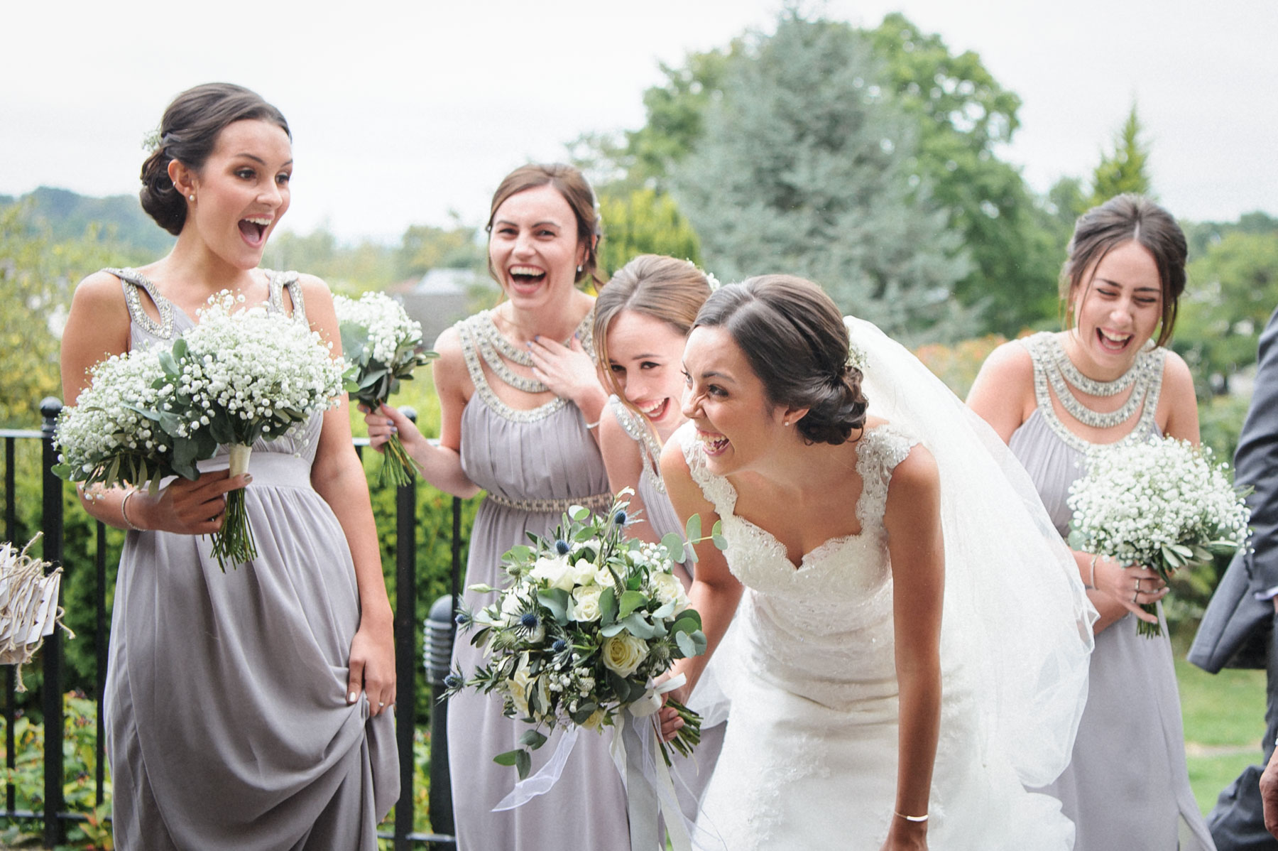 the bridal party share a joke before the ceremony