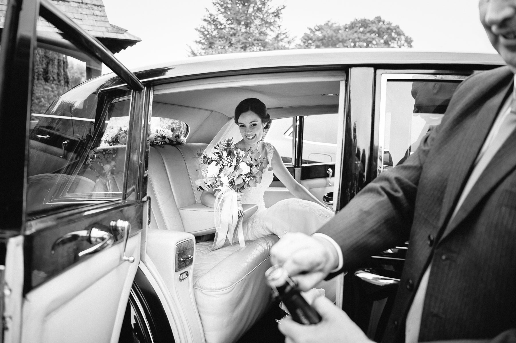 the wedding chauffeur cracks open the champagne