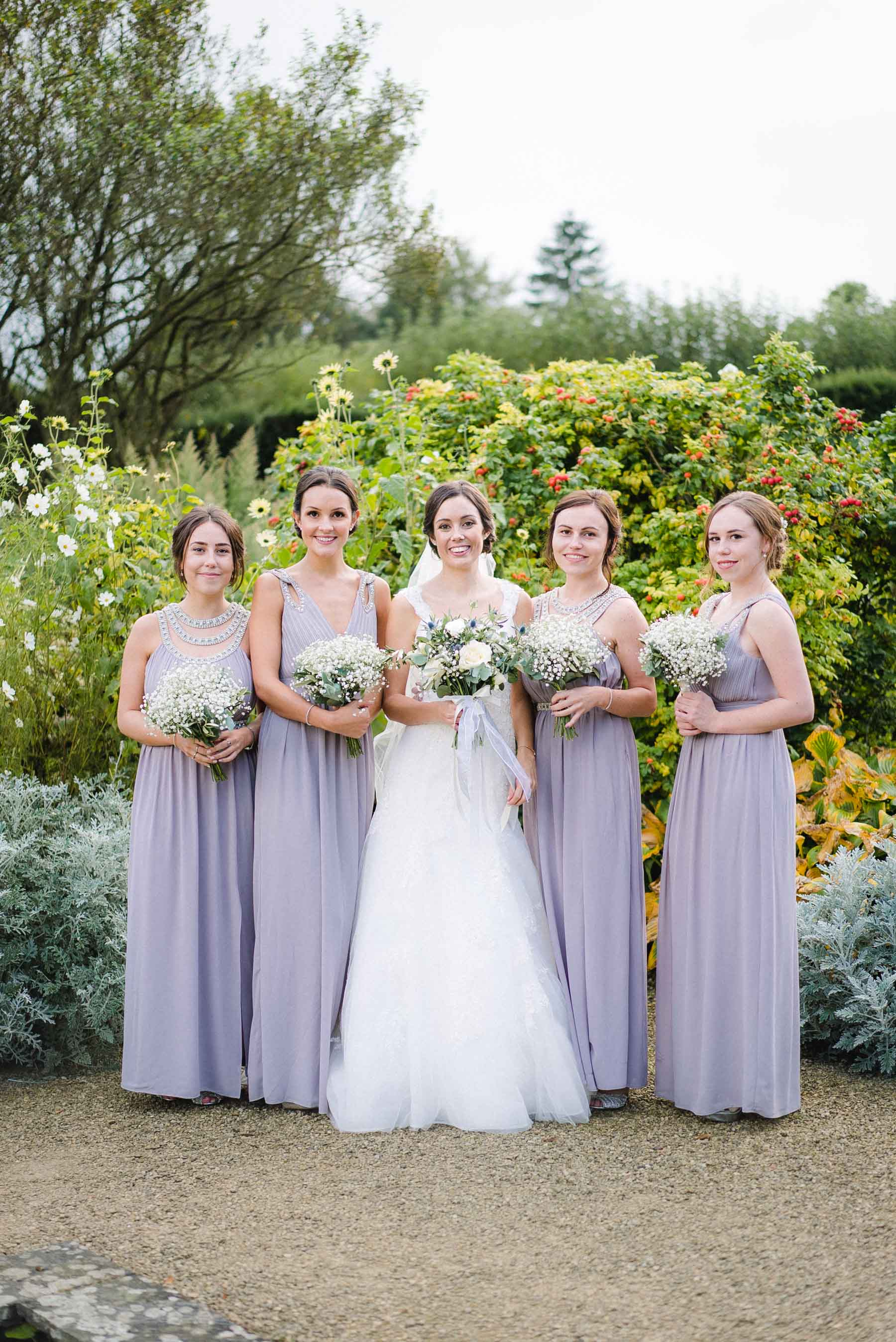 wedding group by Loseley Park Wedding Photographer